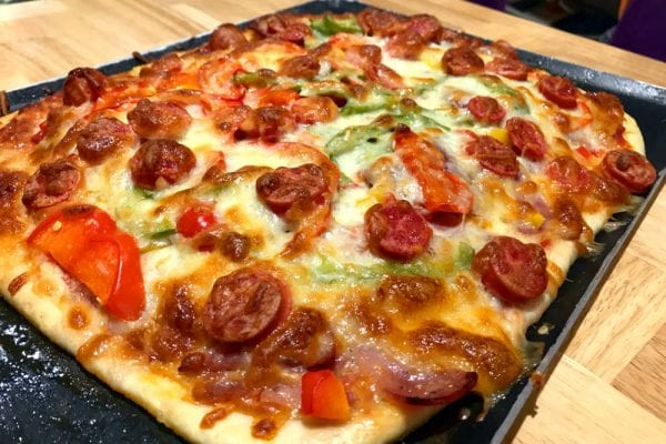 Italian pizza sausage baked during food recipe class