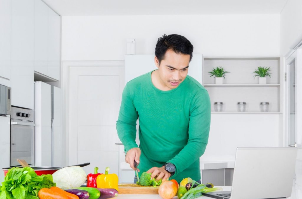 Man Cutting Vegetables